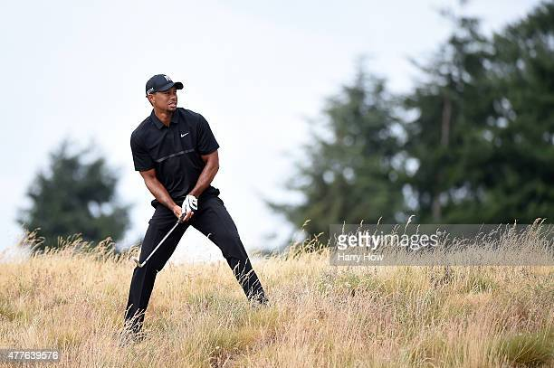 Tiger Woods of the United States waits to play a shot on the eighth hole during the first round of the 115th US Open Championship at Chambers Bay on...