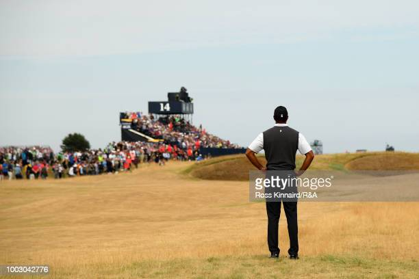 Tiger Woods of the United States waits to play on the 14th hole fairway during round three of the Open Championship at Carnoustie Golf Club on July...