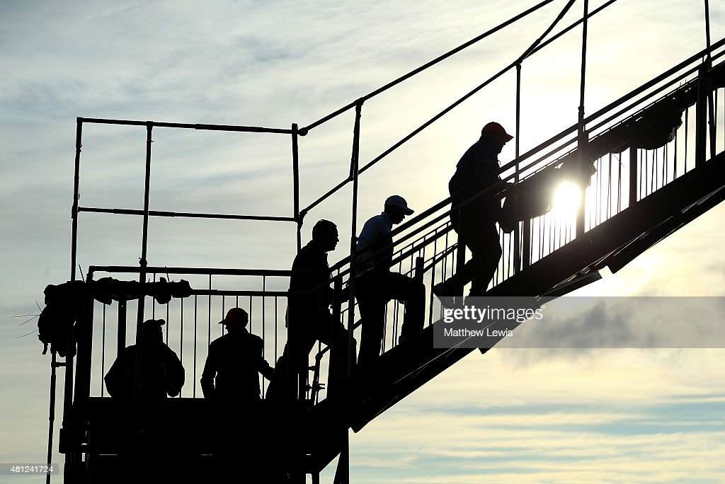 Tiger Woods of the United States (2R) walks across a footbridge after the second round of the 144th Open Championship at The Old Course on July 18, 2015 in St Andrews, Scotland.