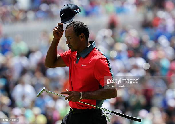Tiger Woods of the United States walks across the 18th green after an evenpar 70 during the final round of the 95th PGA Championship at Oak Hill...