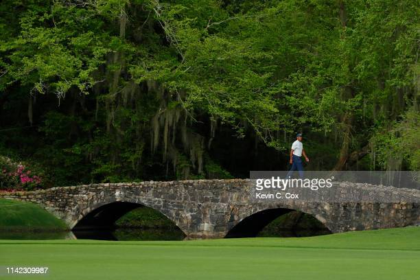 Tiger Woods of the United States walks across the Nelson bridge on the 13th hole during the second round of the Masters at Augusta National Golf Club...