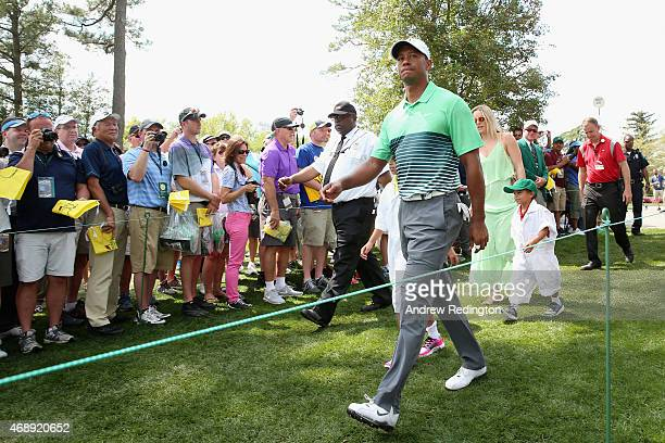 Tiger Woods of the United States walks alongside his girlfriend Lindsey Vonn son Charlie and daughter Sam during the Par 3 Contest prior to the start...