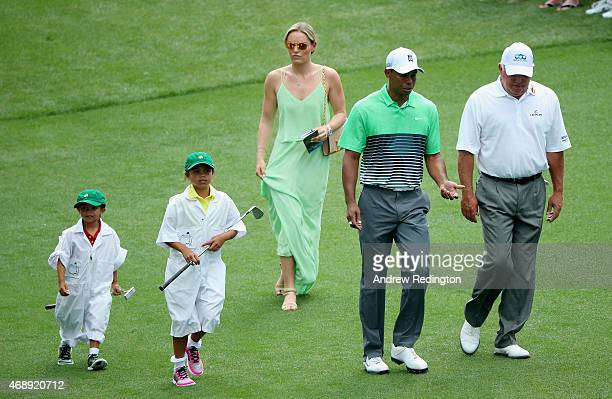 Tiger Woods of the United States walks alongside his girlfriend Lindsey Vonn son Charlie and daughter Sam and friend Mark O'Meara during the Par 3...