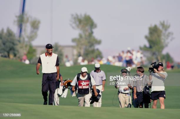 Tiger Woods of the United States walks down the 18th fairway on his way to his first professional golf tournament win at the PGA Las Vegas...