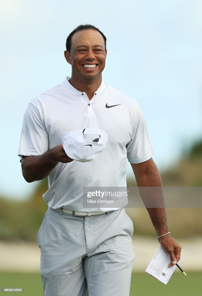 Tiger Woods of the United States walks off of the 18th green after finishing the second round of the Hero World Challenge at Albany, Bahamas on December 1, 2017 in Nassau, Bahamas.
