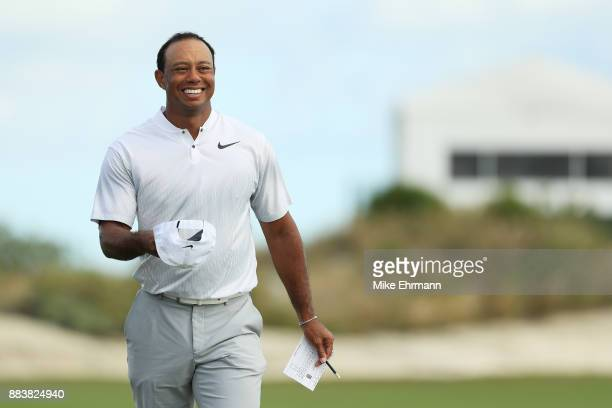 Tiger Woods of the United States walks off of the 18th green after finishing the second round of the Hero World Challenge at Albany Bahamas on...