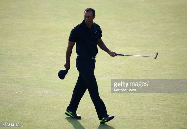 Tiger Woods of the United States walks off the 18th green after holing a birdie putt during the second round of The 143rd Open Championship at Royal...