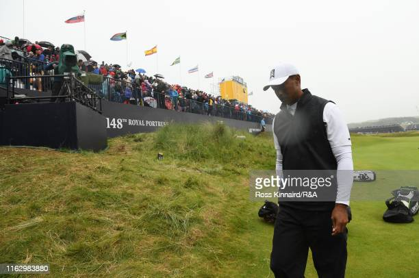 Tiger Woods of the United States walks off the 18th green after finishing his second round of the 148th Open Championship held on the Dunluce Links...