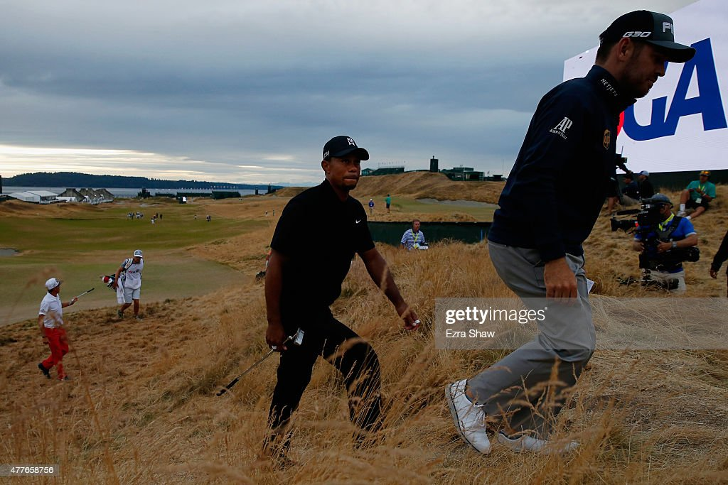 Tiger Woods of the United States walks off the 18th green after completing the first round of the 115th U.S. Open Championship at Chambers Bay on June 18, 2015 in University Place, Washington.