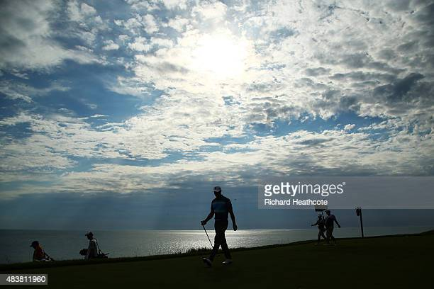Tiger Woods of the United States walks on the 12th hole during the first round of the 2015 PGA Championship at Whistling Straits on August 13 2015 in...