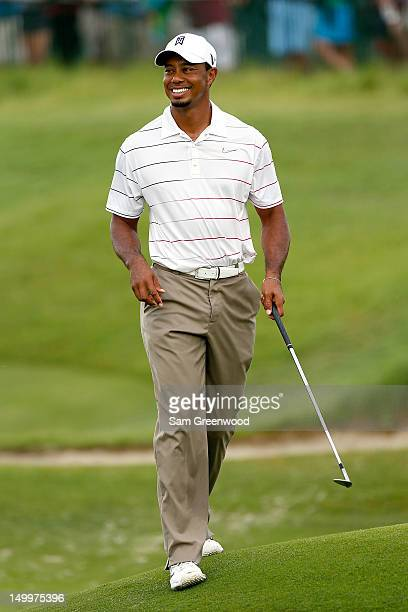 Tiger Woods of the United States walks on the course during a practice round of the 94th PGA Championship at the Ocean Course on August 8 2012 in...