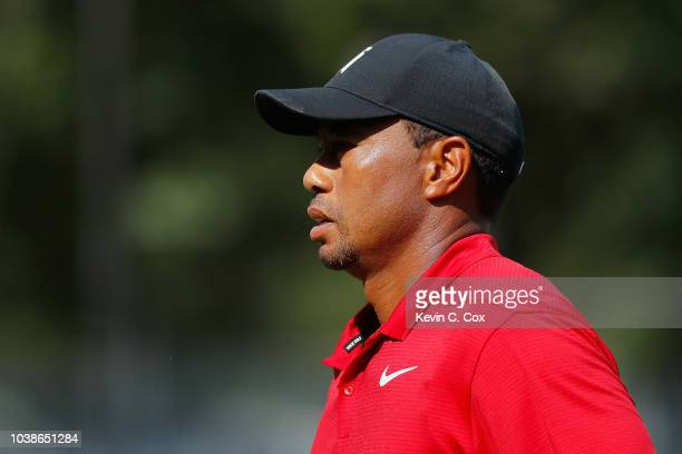Tiger Woods of the United States walks on the ninth hole during the final round of the TOUR Championship at East Lake Golf Club on September 23 2018...