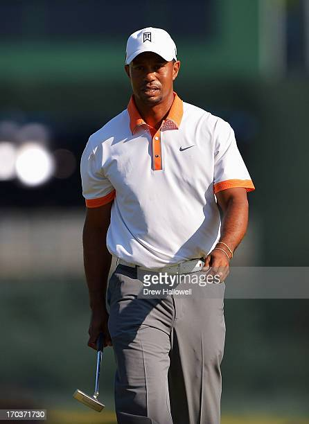 Tiger Woods of the United States walks onto a green during a practice round prior to the start of the 113th U.S. Open at Merion Golf Club on June 12,...