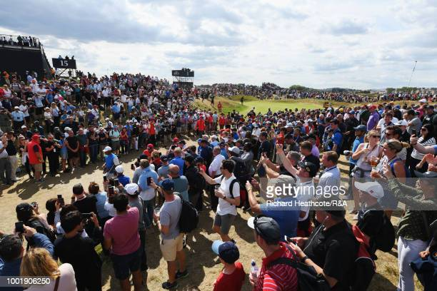 Tiger Woods of the United States walks through the crowds between the 1st green and the 2nd tee during round one of the 147th Open Championship at...