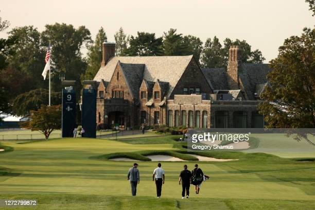 Tiger Woods of the United States walks to his approach shot on the ninth hole as the clubhouse is seen during a practice round prior to the 120th...