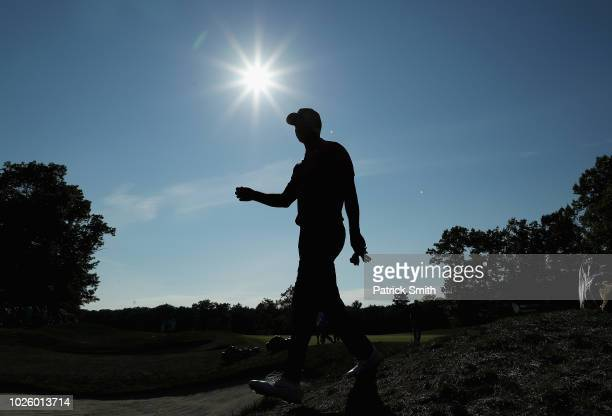 Tiger Woods of the United States walks to the 14th tee box during round two of the Dell Technologies Championship at TPC Boston on September 1, 2018...