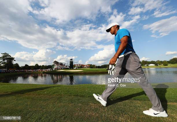 Tiger Woods of the United States walks to the 15th green during the third round of the TOUR Championship at East Lake Golf Club on September 22 2018...