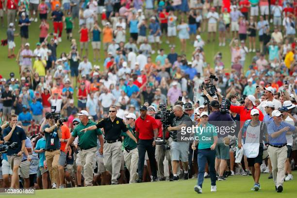 Tiger Woods of the United States walks to the 18th green during the final round of the TOUR Championship at East Lake Golf Club on September 23 2018...