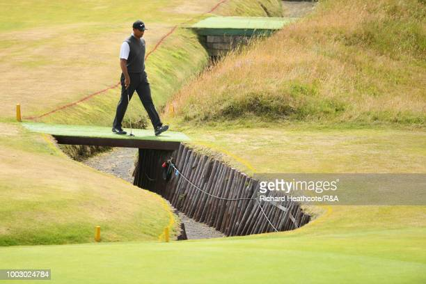 Tiger Woods of the United States walks to the 3rd hole green during round three of the Open Championship at Carnoustie Golf Club on July 21 2018 in...