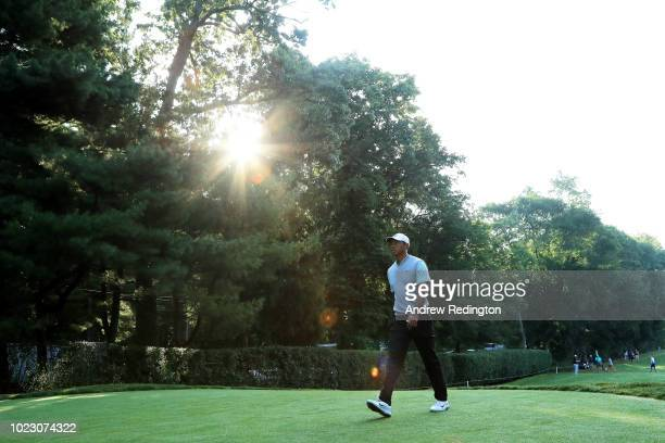 Tiger Woods of the United States walks to the first tee during the third round of The Northern Trust on August 25 2018 at the Ridgewood Championship...