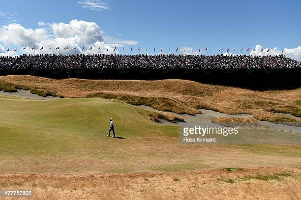 Tiger Woods of the United States walks up the 18th fairway during the second round of the 115th US Open Championship at Chambers Bay on June 19 2015...