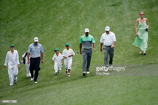 Tiger Woods of the United States walks with his girlfriend Lindsey Vonn, son Charlie and daughter Sam and friends Mark O'Meara and Steve Stricker...