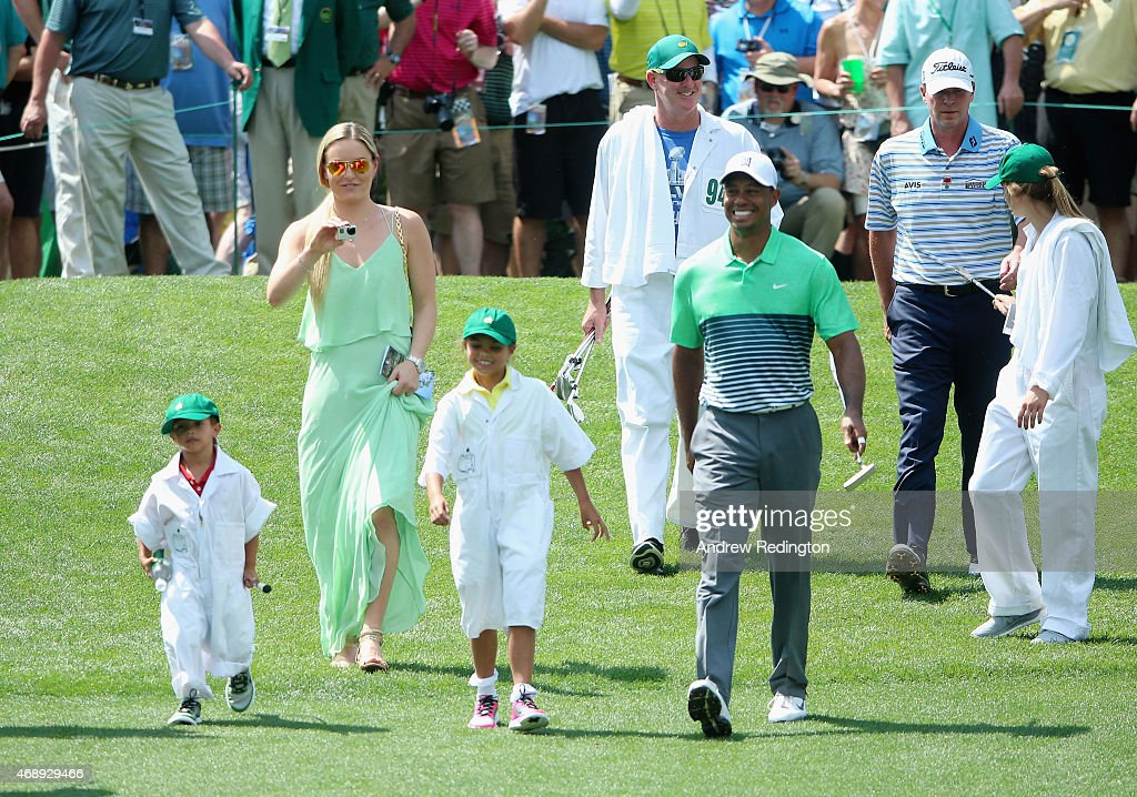 Tiger Woods of the United States (C) walks with his girlfriend Lindsey Vonn, son Charlie and daughter Sam and friend Steve Stricker during the Par 3 Contest prior to the start of the 2015 Masters Tournament at Augusta National Golf Club on April 8, 2015 in Augusta, Georgia.