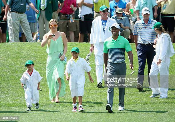 Tiger Woods of the United States walks with his girlfriend Lindsey Vonn, son Charlie and daughter Sam and friend Steve Stricker during the Par 3...