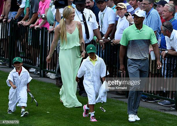 Tiger Woods of the United States walks with his girlfriend Lindsey Vonn son Charlie and daughter Sam during the par 3 contest prior to the start of...