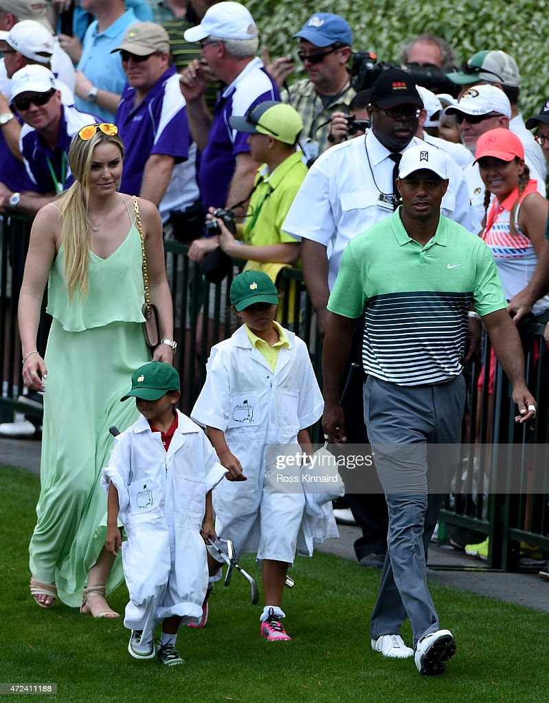 Tiger Woods of the United States (R) walks with his girlfriend Lindsey Vonn, son Charlie and daughter Sam during the par 3 contest prior to the start of the 2015 Masters Tournament at Augusta National Golf Club on April 8, 2015 in Augusta, Georgia.