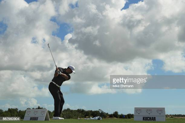 Tiger Woods of the United States warms up on the range for the first round of the Hero World Challenge at Albany, Bahamas on November 30, 2017 in...
