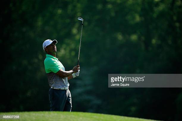 Tiger Woods of the United States watches a tee shot during a practice round prior to the start of the 2015 Masters Tournament at Augusta National...