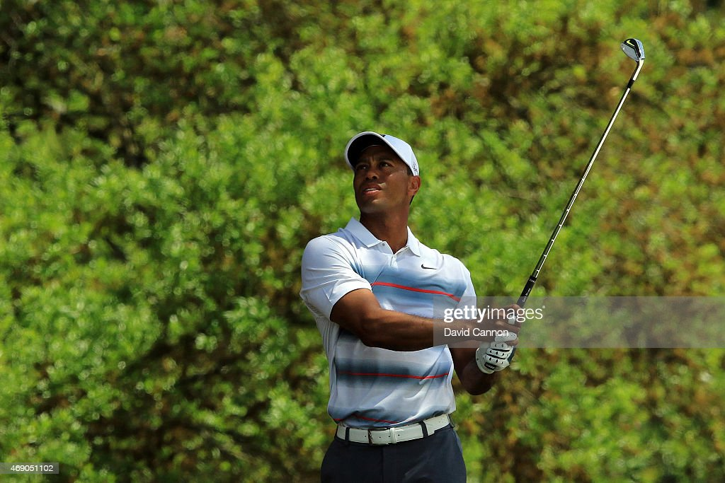 Tiger Woods of the United States watches his second shot on the first hole during the first round of the 2015 Masters Tournament at Augusta National Golf Club on April 9, 2015 in Augusta, Georgia.