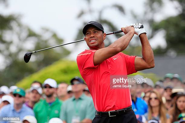 Tiger Woods of the United States watches his tee shot on the first hole during the final round of the 2015 Masters Tournament at Augusta National...