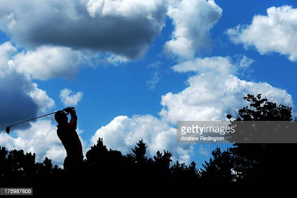Tiger Woods of the United States watches his tee shot on the fourth hole during the final round of the 95th PGA Championship at Oak Hill Country Club...
