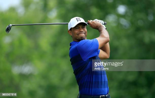 Tiger Woods of the United States watches his tee shot on the third during the second round of The Memorial Tournament Presented by Nationwide at...