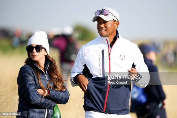 Tiger Woods of the United States watches on with girlfriend Erica Herman during the afternoon foursome matches of the 2018 Ryder Cup at Le Golf...
