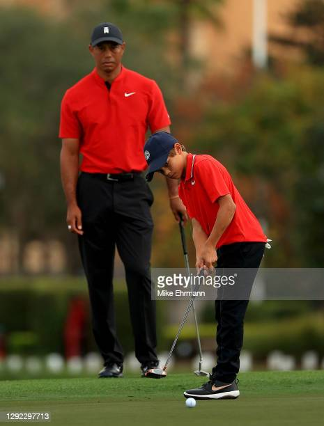 Tiger Woods of the United States watches son Charlie Woods putt on the 18th hole during the final round of the PNC Championship at the Ritz Carlton...