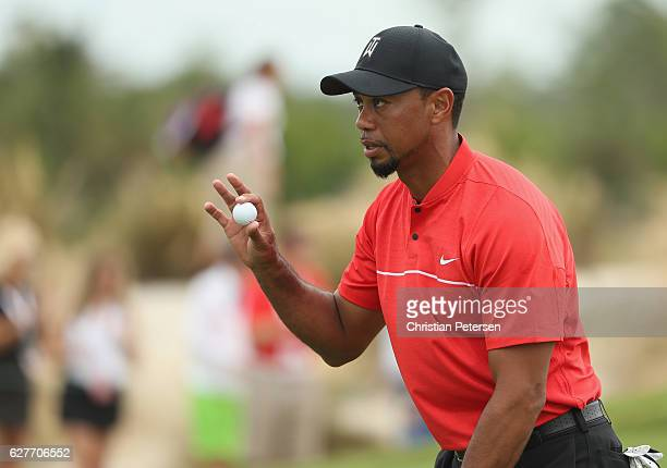 Tiger Woods of the United States waves during the final round of the Hero World Challenge at Albany The Bahamas on December 4 2016 in Nassau Bahamas