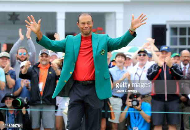Tiger Woods of the United States waves to the patrons during the Green Jacket presentation after his historic one shot win during the final round of...