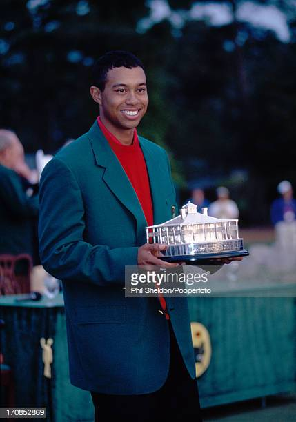 Tiger Woods of the United States wearing the Green Jacket and holding the trophy after winning the US Masters Golf Tournament held at the Augusta...