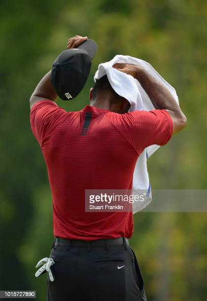 Tiger Woods of the United States wipes his head with a towel during the final round of the 2018 PGA Championship at Bellerive Country Club on August...
