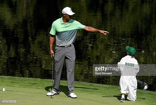 Tiger Woods of the United States with his son Charlie during the par three contest prior to the start of the 2015 Masters Tournament at Augusta...