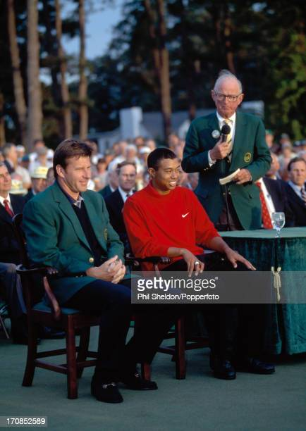 Tiger Woods of the United States with Nick Faldo about to be presented with the Green Jacket for winning the US Masters Golf Tournament held at the...