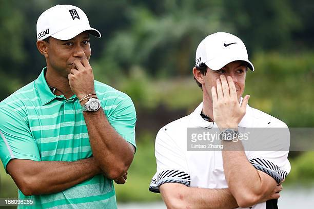 Tiger Woods of the United States with Rory McIlroy of Northern Ireland react at Blackstone Course Mission Hills on October 28 2013 in Haikou China