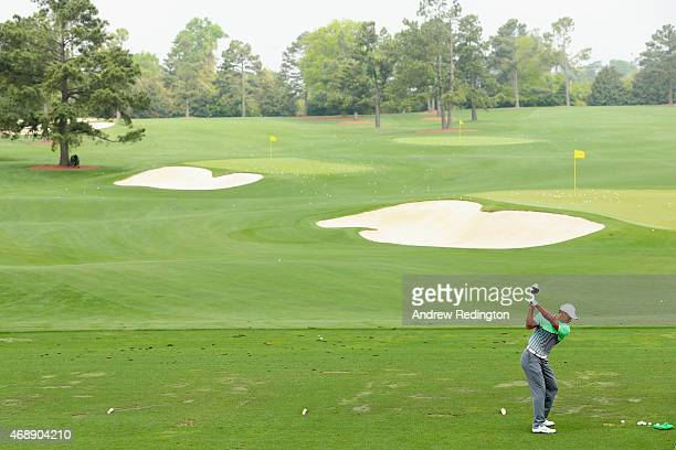 Tiger Woods of the United States works on the practice ground during a practice round prior to the start of the 2015 Masters Tournament at Augusta...