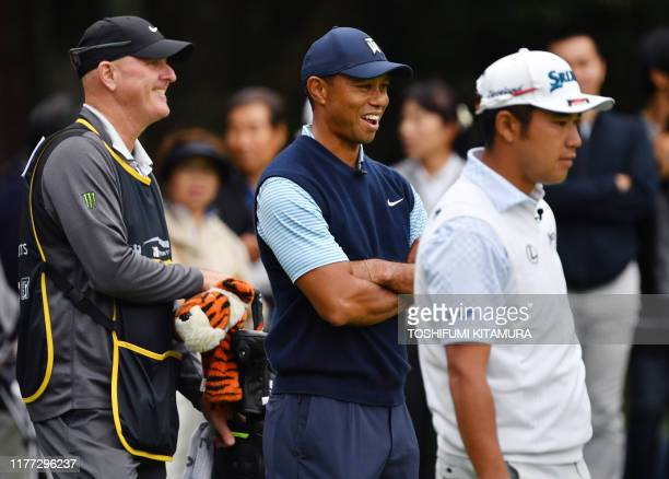 Tiger Woods of the US and Hideki Matsuyama of Japan watch other players on the first hole green at a Japan Skins prematch ahead of the Zozo...