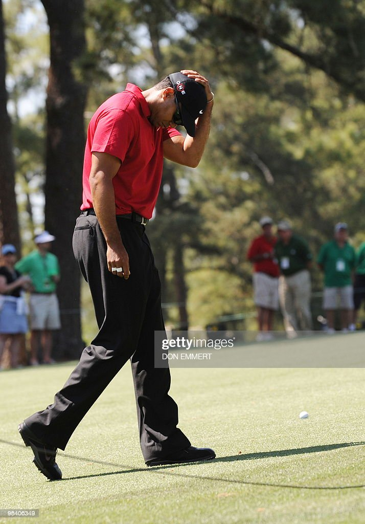 Tiger Woods of the US arrives on the 9th hole fairway to make his approach to the 1st hole during the final round of the Masters Golf Tournament at Augusta National Golf Club on April 11, 2010 in Augusta, Georgia. A bad tee shot from the 1st hole put Woods' ball in the 9th fairway.