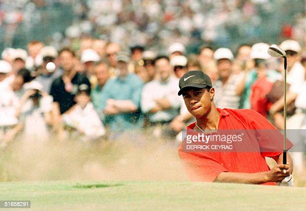 Tiger Woods of the US blast out of a bunker on the final day of the 126th British Open Golf Championship 20 July at Royal Troon