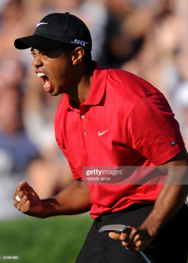 Tiger Woods of the US celebrates his birdie putt on the 18th hole in the fourth round of the 108th U.S. Open golf tournament at Torrey Pines Golf Course in San Diego, California on June 15, 2008. Woods' finished tied for the lead with compatriot Rocco Mediate, forcing a playoff to take place on June 16.